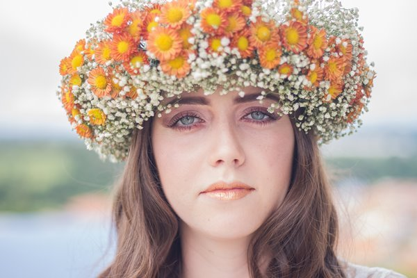 Girl with a glowing skin and a flower crown