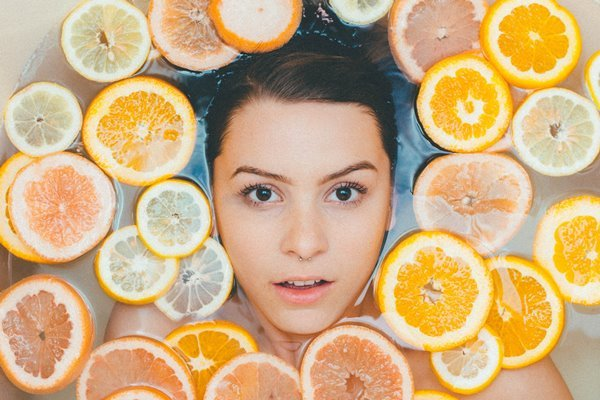 Woman soaked in Citrus Fruit Bath